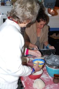 choosing polenta to decorate dough